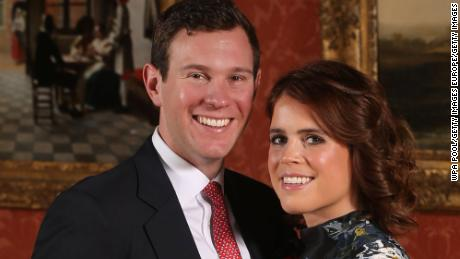 LONDON, ENGLAND -JANUARY 22: (EDITOR'S NOTE: Alternative crop of image #908732602) Princess Eugenie and Jack Brooksbank pose in the Picture Gallery at Buckingham Palace after they announced their engagement. Princess Eugenie wears a dress by Erdem, shoes by Jimmy Choo and a ring containing a padparadscha sapphire surrounded by diamonds on January 22, 2018 in London, England..  They are to marry at St George's Chapel in Windsor Castle in the autumn this year. (Photo by Jonathan Brady - WPA Pool/Getty Images)