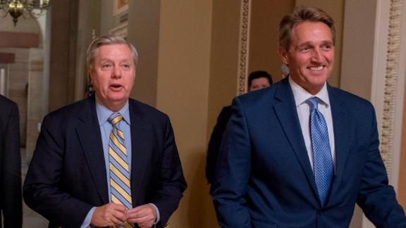 WASHINGTON, DC - JANUARY 20:  (L-R) Senator Lindsey Graham (R-SC) and Senator Jeff Flake (R-AZ) speak to the media on Capitol Hill on January 20, 2018 in Washington, DC. The U.S. government is shut down after the Senate failed to pass a resolution to temporarily fund the government through February 16.  (Photo by Tasos Katopodis/Getty Images)