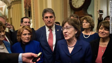 Senator Susan M. Collins (R-ME) speaks to reporters with Democratic and Republican Senators on Capitol Hill after the Senate moved to end a government shutdown January 22, 2018 in Washington, DC. / AFP PHOTO / Brendan Smialowski        (Photo credit should read BRENDAN SMIALOWSKI/AFP/Getty Images)
