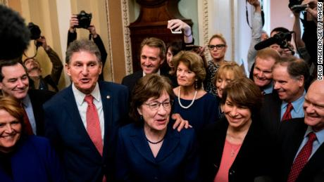 Senators Joe Manchin (D-WV) and Susan Collins (R-ME) lead a group of bipartisan Senators as they speak to reporters after the Senate passed a procedural vote for a continuing resolution to fund the federal government on Monday. (Photo by Drew Angerer/Getty Images)