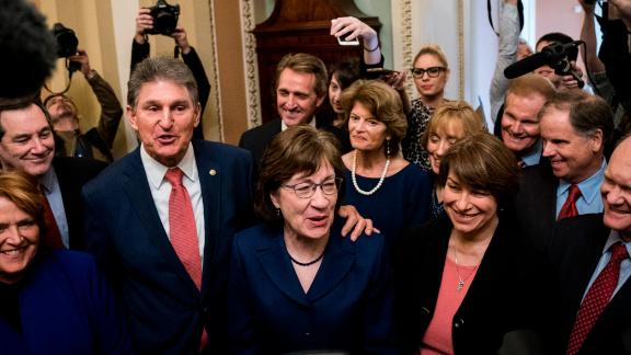 Senators Joe Manchin (D-WV) and Susan Collins (R-ME) lead a group of bipartisan Senators as they speak to reporters after the Senate passed a procedural vote for a continuing resolution to fund the federal government, Capitol Hill, January 22, 2018 in Washington, DC. Lawmakers are continuing to seek a deal to end the government shutdown, now in day three. (Photo by Drew Angerer/Getty Images)