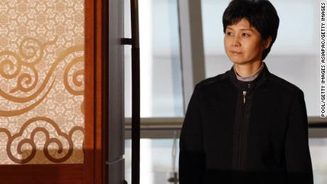 Former North Korean spy Kim Hyon Hui arrives for a press conference with Shigeo Iizuka and Koichiro Iizuka, family members of Yaeko Taguchi, on March 11, 2009.