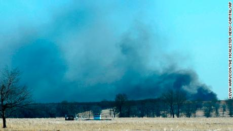 Smoke billows from the site of a gas well fire near Quinton, Oklahoma, early on January 22, 2018.