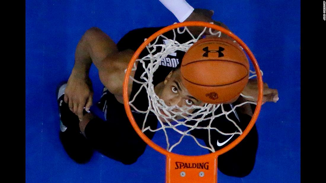 Xavier guard Paul Scruggs watches his shot enter the hoop during the first half of an NCAA college basketball game against Seton Hall on Saturday, January 20, in Newark, New Jersey. Xavier won 73-64 against Seton Hall.