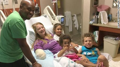 Tiffany Johnson was reunited with her children after surviving a shark attack.