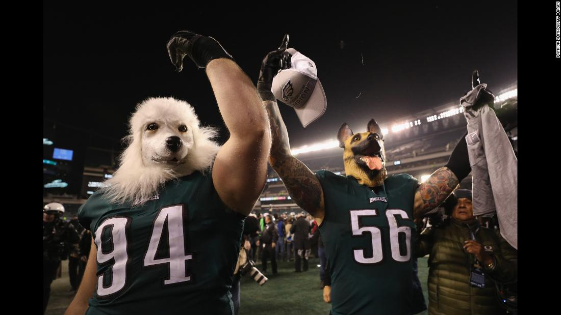 Philadelphia Eagles' defensive tackle, Beau Allen, left and defensive end, Chris Long, right, celebrate their team's win over the Minnesota Vikings in the NFC Championship game while wearing dog masks on Sunday, January 21, in Philadelphia, Pennsylvania.<br />