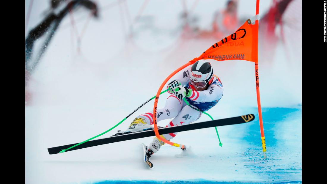 "Patrick Schweiger of Austria tangles with a gate during the Audi FIS Alpine Ski World Cup Men's Downhill on Saturday, January 20, in Kitzbuehel, Austria. <a href=""http://edition.cnn.com/2018/01/20/sport/gallery/kitzbuhel-downhill-world-cup-skiing-2018/index.html"" target=""_blank"">See more photos from this race</a>"
