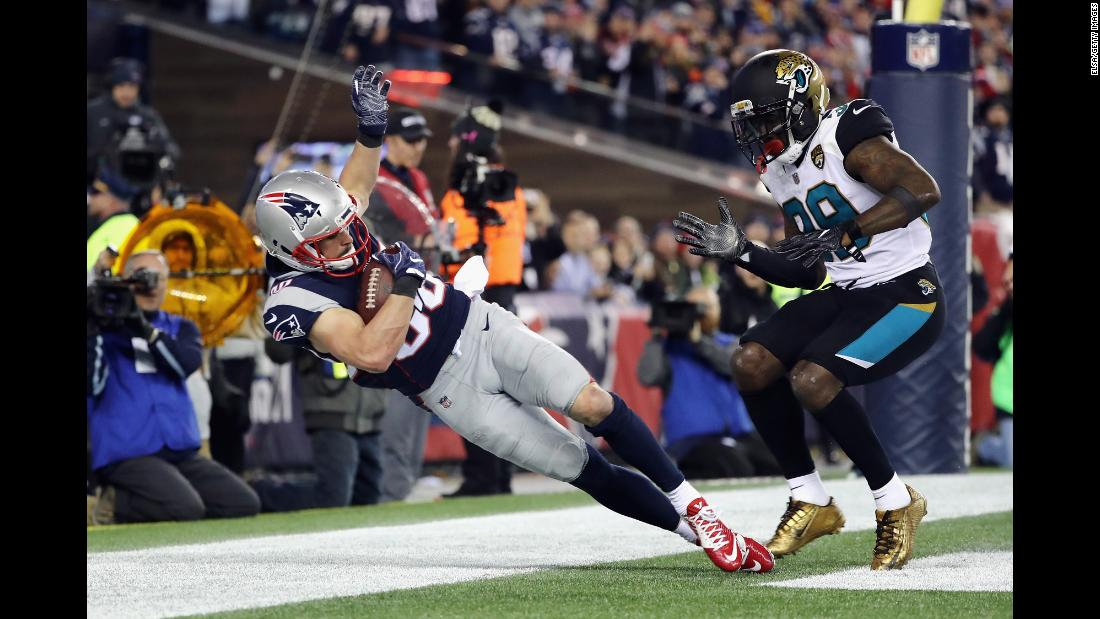 Patriots wide receiver Danny Amendola catches a touchdown pass as he is defended by the Jaguars' Tashaun Gipson in the fourth quarter during the AFC Championship Game on Sunday, January 21, in Foxborough, Massachusetts.<br />