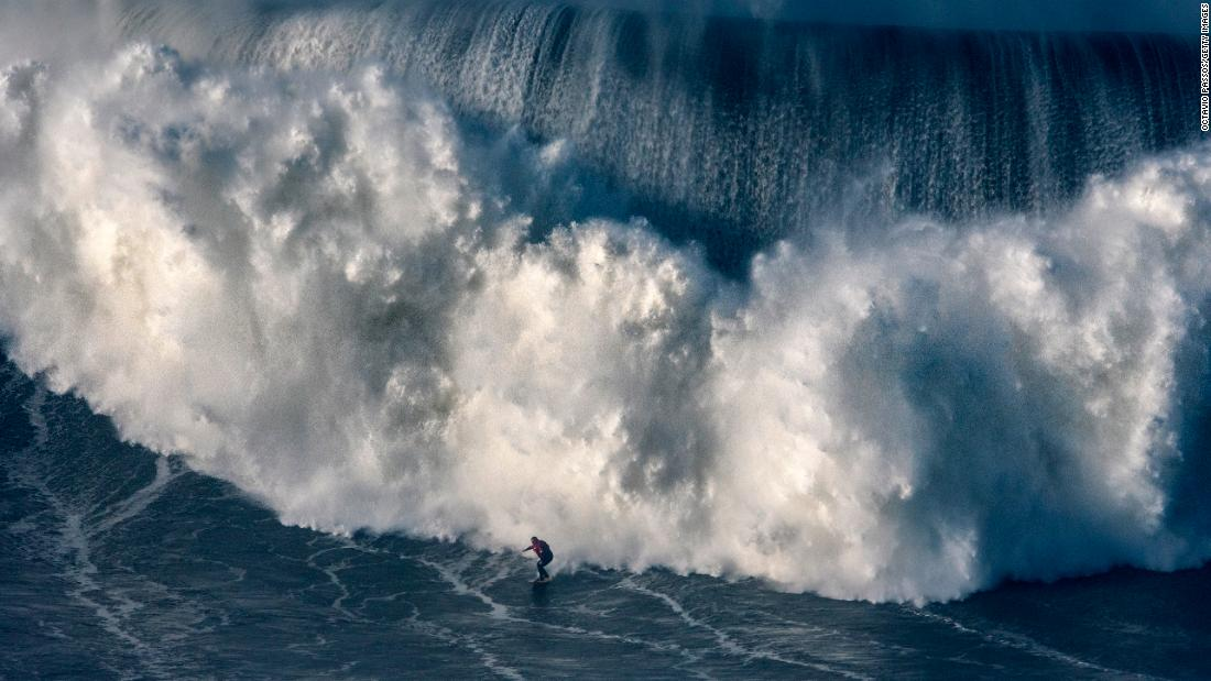 Australian big wave surfer Ross Clarke-Jones drops a wave during a surf session at Praia do Norte on Thursday, January 18, in Nazare, Portugal. Nazare is known for its massive waves, reportedly created by a deep undersea canyon combined with winter storms.