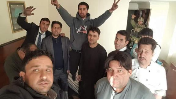 Abdulhaq Omeri (front left) and other survivors at the Intercontinental Hotel after security forces ended the siege.