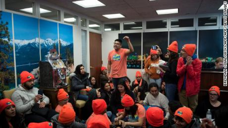 "People advocate for Dreamers sit in the lobby of Senator Dean Heller (R-NV)'s office on Capitol Hill January 16, 2018 in Washington, DC. US President Donald Trump said Tuesday he wants immigrants to come to the United States ""from everywhere,"" according to participants at a White House meeting -- a remark in stark contrast with his alleged denunciation of immigration from ""shithole countries"" last week. / AFP PHOTO / Brendan Smialowski        (Photo credit should read BRENDAN SMIALOWSKI/AFP/Getty Images)"