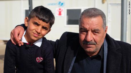 Ayman with his uncle, Tahsin Elias, who is now his guardian.