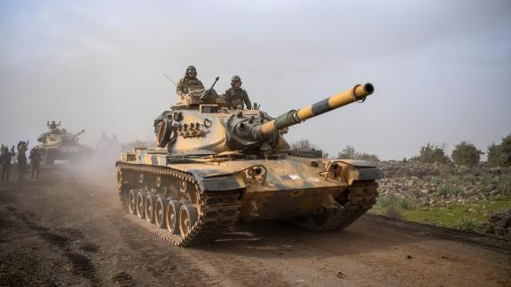 "Turkish army tanks enter Afrin, an enclave in northern Syria controlled by U.S.-allied Kurdish fighters, in Hassa, Hatay, Turkey, Monday, Jan. 22, 2018. Turkey's President Recep Tayyip Erdogan has said his country will ""not take a step back"" from its military operation on Afrin. Speaking in Ankara on Monday_the third day of the operation— Erdogan said Turkey's ""fundamental goal"" is ensuring national security, preserving Syria's territorial integrity and protecting the Syrian people.(AP Photo)"