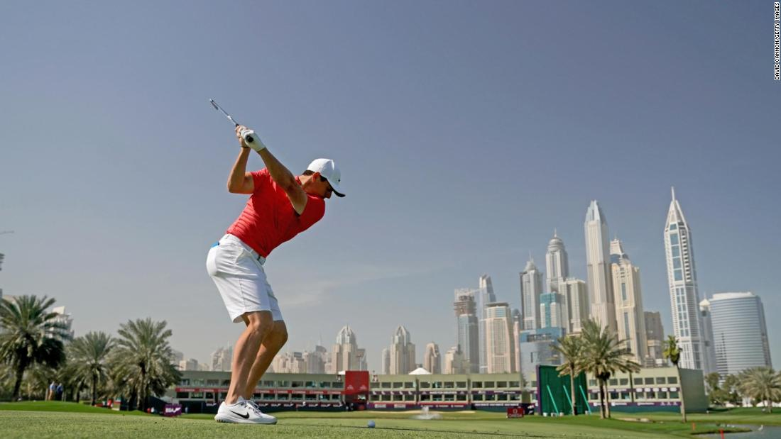 <strong>Reach for the sky:</strong> A fit-again Rory McIlroy drives on the 18th hole Majlis Course at the Emirates Golf Club in practice for the Omega Dubai Desert Classic on the European Tour.