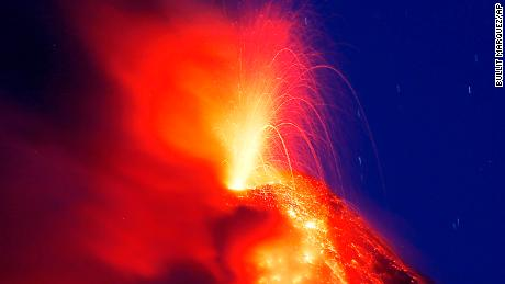 Mayon volcano erupts for the second straight day as lava cascades down its slopes Tuesday, January 23.