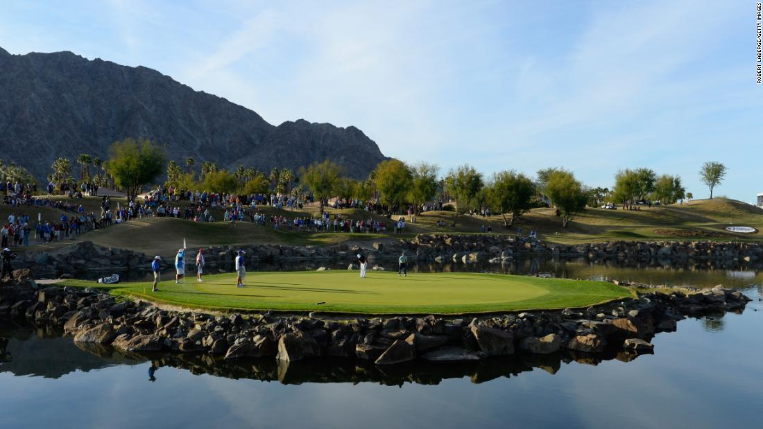 <strong>Island green:</strong> Players putt on the 17th hole of the TPC Stadium course at PGA West in La Quinta, California during the final round of the CareerBuilder Challenge on the PGA Tour.
