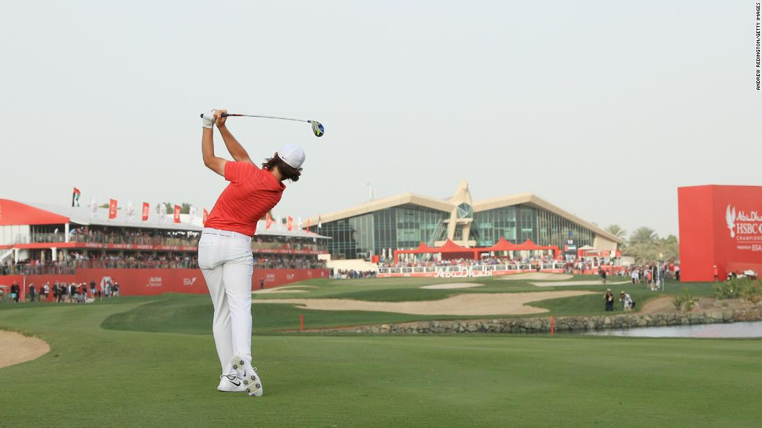 <strong>Final stretch:</strong> England's Tommy Fleetwood fires towards the final green on his way to winning the Abu Dhabi HSBC Golf Championship.