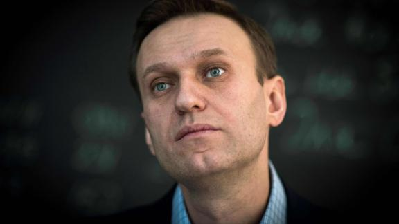 """Russian opposition leader Alexei Navalny looks on during an interview with AFP at the office of his Anti-corruption Foundation (FBK) in Moscow on January 16, 2018. The Kremlin's top critic Alexei Navalny has slammed Russia's March presidential election, in which he is barred from running, as a sham meant to """"re-appoint"""" Vladimir Putin on his way to becoming """"emperor for life"""". / AFP PHOTO / Mladen ANTONOV        (Photo credit should read MLADEN ANTONOV/AFP/Getty Images)"""