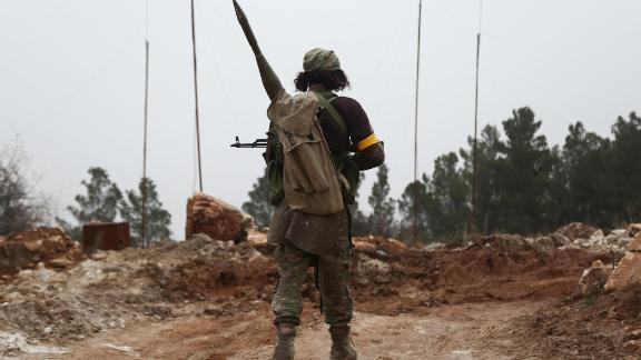 "A Turkish-backed Syrian rebel fighter is seen around the area of Mount Bersaya, north of the Syrian town of Azaz near the border with Turkey, on January 22, 2018. The Turkish military on January 20 launched operation ""Olive Branch"", its second major incursion into Syrian territory during the seven-year civil war. The operation, with Turkish war planes and artillery backing a major ground incursion involving Ankara-backed Syrian rebels and Turkish tanks, aims to oust the People's Protection Units (YPG) militia from its Afrin enclave. / AFP PHOTO / Nazeer al-Khatib        (Photo credit should read NAZEER AL-KHATIB/AFP/Getty Images)"
