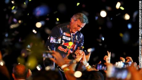 CORDOBA, ARGENTINA - JANUARY 20:  Carlos Sainz of Spain and Peugeot Total celebrates victory with their team on the podium after stage fourteen of the 2018 Dakar Rally, a loop stage to and from Cordoba on January 20, 2018 in Cordoba, Argentina.  (Photo by Dan Istitene/Getty Images)