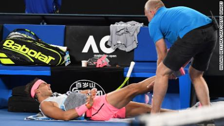 Rafael Nadal receives a medical timeout.