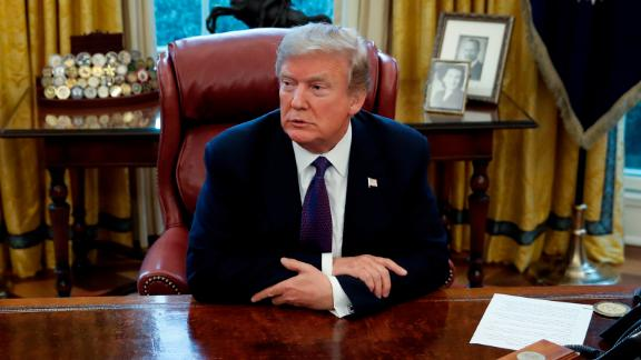 """President Donald Trump sits at the Resolute Desk after signing Section 201 actions in the Oval Office of the White House in Washington, Tuesday, Jan. 23, 2018. Trump says he is imposing new tariffs to """"protect American jobs and American workers."""" Trump acted to impose new tariffs on imported solar-energy components and large washing machines in a bid to help U.S. manufacturers. (AP Photo/Carolyn Kaster)"""