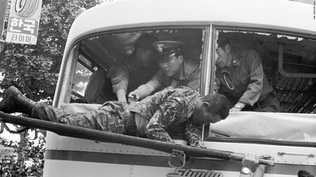 South Korean security forces carry one of the Unit 684 survivors in 1971. A 2006 Defense Ministry Truth Commision report revealed 20 mutineers were killed on board the bus. Four survivors were later executed.