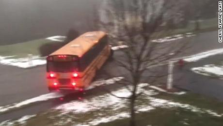 School bus loses control, slides down icy hill