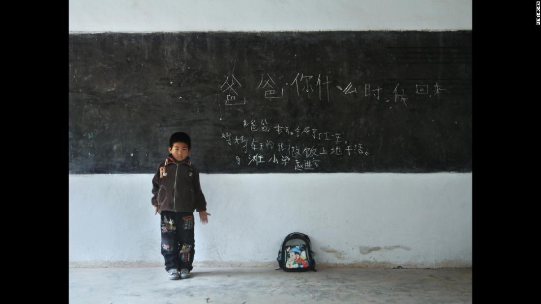 "Zhao Jinbao, 7, Matan Elementary School, Gansu. His message reads: ""Dad, when are you coming back? My dad went to Baiyin to work for a year. Mom cooks and works in the field.""<br />"