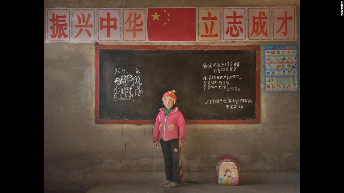 "Wang Baohua, 11, Majiawan Elementary School, Longmen County, Gansu. ""My dad comes to join my mom's family. I like daddy. He always buys me good stuff. Daddy and mommy love each other. Grandpa and grandma also like dad. Happy family.""<br />"