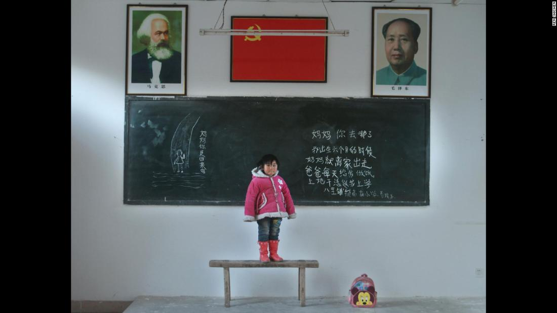 "For more than a three years, photographer Ren Shichen has traveled around China taking portraits of the country's left-behind children. <br />Each child poses in a classroom with a message for their absent parents on the blackboard behind them.  Here, Gou Lingyu, 6, from Gaomiao Elementary School, Balipu County asks:  ""Mommy, where did you go? Mommy left home when I was six months old. Daddy cooks for me every day and works in the field and takes me to school. On the left hand side of the board is written: ""Mommy, are you coming back?"" <br />"