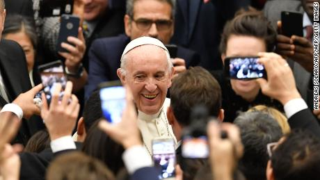 Pope Francis smiles as he arrives for his weekly general audience at the Paul VI audience hall on December 13, 2017 at the Vatican.  / AFP PHOTO / Andreas SOLARO        (Photo credit should read ANDREAS SOLARO/AFP/Getty Images)