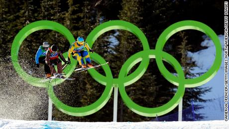 VANCOUVER, BC - FEBRUARY 21:  (L-R) Filip Flisar of Slovenia, Christopher Delbosco of Canada and Tommy Eliasson of Sweden compete in a men's ski cross race on day ten of the Vancouver 2010 Winter Olympics at Cypress Mountain Resort on February 21, 2010 in Vancouver, Canada.  (Photo by Cameron Spencer/Getty Images)