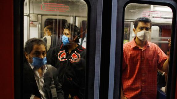 MEXICO CITY - APRIL 28: People wear surgical masks as they ride the subway on April 28, 2009 in Mexico City, Mexico. Reports indicate that most people confirmed with the new swine flu were infected in Mexico, where the number of deaths blamed on the virus has surpassed 150. (Photo by Joe Raedle/Getty Images)