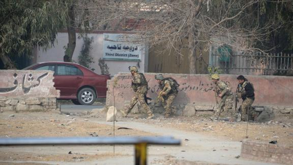 Afghan army soldiers take positions near the global charity's office Wednesday.