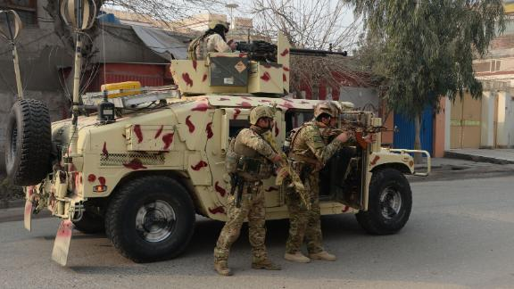 Soldiers stand behind a vehicle Wednesday in Jalalabad.