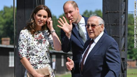 Catherine, Duchess of Cambridge (L), and Prince William, Duke of Cambridge, meet Manfred Goldberg as they visit the former Stutthof Nazi concentration camp during an official visit to Poland.
