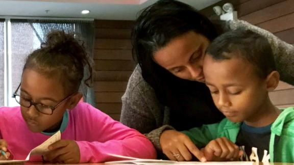 Milagros Bosse and her children are among the Puerto Ricans who are losing housing aid this weekend.