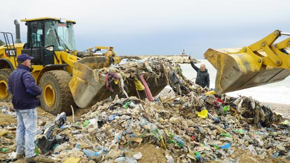 Bulldozers at a trash-infested beach in north Beirut help to clear the garbage.