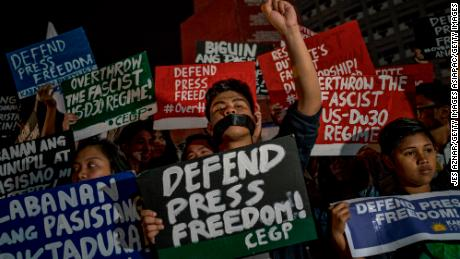 Journalists and activists stage a protest calling to defend press freedom on January 19, 2018, in Quezon City, Metro Manila, Philippines following the SEC decision to withdraw Rappler's license.
