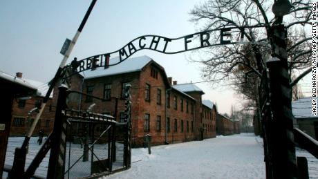 "This picture taken on December 18, 2009 shows a replica hung in place of the stolen infamous ""Arbeit macht frei"" sign at the former Nazi death camp Auschwitz in Oswiecim, Poland.  The theft of the infamous ""Arbeit macht frei"" sign at the Nazi German-era Auschwitz death camp in Poland sparked outrage on December 18, 2009, as police launched a hunt for the perpetrators. ""The inscription was stolen early this morning,"" Auschwitz-Birkenau Museum spokesman Jaroslaw Mensfelt told AFP, adding that the thieves must have known what they were doing.  AFP PHOTO/PAP/JACEK BEDNARCZYK - POLAND OUT - (Photo credit should read JACEK BEDNARCZYK/AFP/Getty Images)"