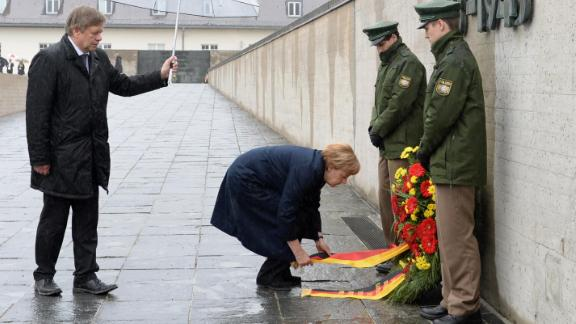 German Chancellor Angela Merkel lays a wreath at the International Memorial of former Nazi concentration camp of Dachau, southwestern Germany, on May 3, 2015.