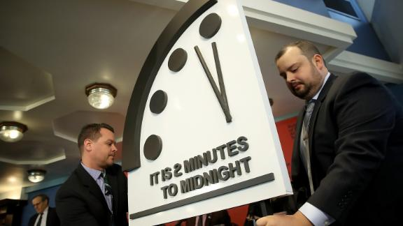 "WASHINGTON, DC - JANUARY 25:  The Bulletin of the Atomic Scientists unveil the 2018 ""Doomsday Clock"" January 25, 2018 in Washington, DC. Citing growing nuclear risks and unchecked climate dangers, the group moved the clock to two minutes before midnight, 30 seconds closer and the closest it has been since the height of the Cold War in 1953. (Photo by Win McNamee/Getty Images)"
