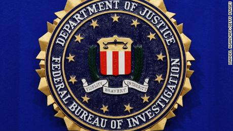 "The Federal Bureau of Investigation (FBI) seal is seen on the lectern following a press conference announcing the FBI's 499th and 500th additions to the ""Ten Most Wanted Fugitives"" list on June 17, 2013 at the Newseum in Washington, DC. AFP PHOTO/Mandel NGAN        (Photo credit should read MANDEL NGAN/AFP/Getty Images)"