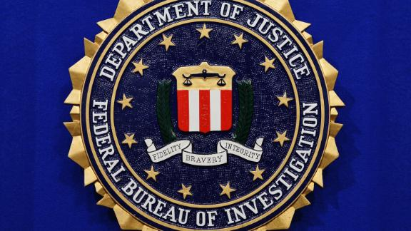 """The Federal Bureau of Investigation (FBI) seal is seen on the lectern following a press conference announcing the FBI's 499th and 500th additions to the """"Ten Most Wanted Fugitives"""" list on June 17, 2013 at the Newseum in Washington, DC. AFP PHOTO/Mandel NGAN        (Photo credit should read MANDEL NGAN/AFP/Getty Images)"""