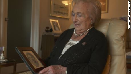 Freda Wineman looks at a photo of her mother who was killed at Auschwitz.
