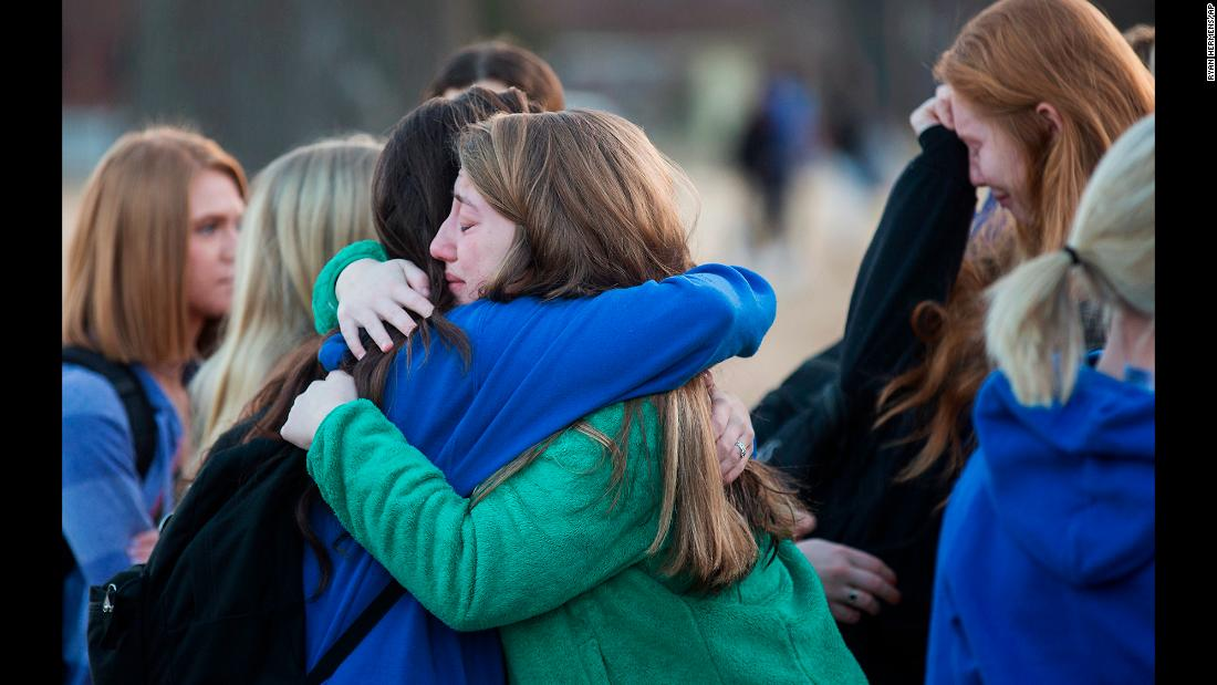 "Students embrace following a prayer vigil in Paducah, Kentucky, on Wednesday, January 24, one day after a <a href=""http://www.cnn.com/2018/01/23/us/kentucky-high-school-shooting/index.html"" target=""_blank"">mass shooting at Marshall County High School</a> in Benton, Kentucky. Sixteen people were wounded, <a href=""http://www.cnn.com/2018/01/25/us/kentucky-school-shooting/index.html"" target=""_blank"">two of them fatally</a>, authorities said. Four others sustained various injuries. The 15-year-old suspect -- who has been charged with two counts of murder and 12 counts of first-degree assault -- made his first court appearance on Thursday morning, Marshall County Assistant Attorney Jason Darnall said."