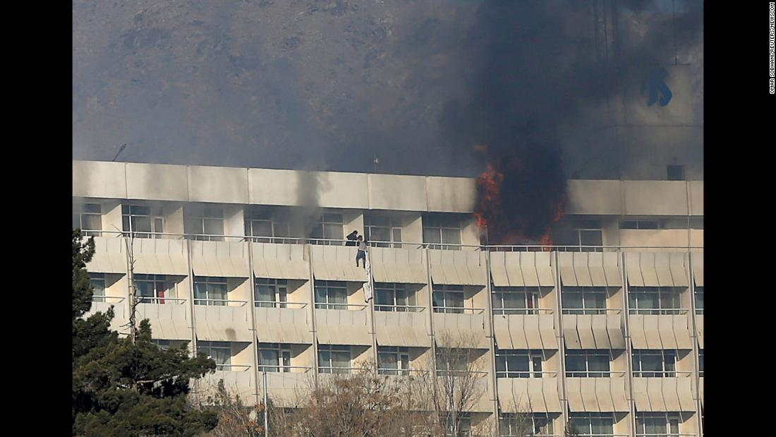 "A man tries to escape from a balcony at Kabul's Intercontinental Hotel during an attack in Kabul, Afghanistan, on Sunday, January 21. Gunmen who raided the hotel <a href=""http://www.cnn.com/2018/01/21/asia/intercontinental-hotel-kabul-siege/index.html"" target=""_blank"">killed at least 18 people during a 12-hour standoff</a> with security forces, Afghan authorities said."