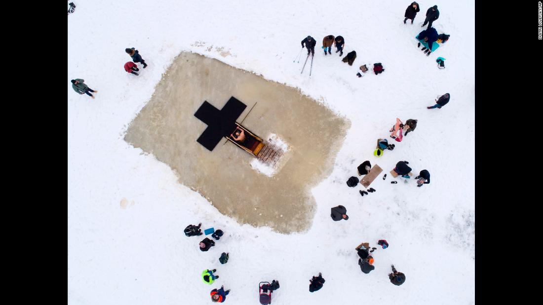 "Members of the Russian Orthodox Church mark the feast of the Epiphany at an icy lake in Orlino village, about 70 kilometers (43 miles) south of St. Petersburg, Russia, on Friday, January 19. <a href=""http://www.cnn.com/2018/01/19/europe/putin-icy-dip-intl/index.html"" target=""_blank"">Russian President Vladimir Putin also took an icy plunge</a> in Lake Seliger, north of Moscow, as part of the traditional Orthodox Christian ritual which commemorates the baptism of Jesus."