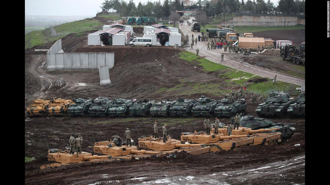 "Turkish army tanks and armored personnel carriers (APC) are seen near the Turkish-Syrian border in Hatay province, Turkey, on Tuesday, January 23. <a href=""http://www.cnn.com/2018/01/23/middleeast/turkey-syria-afrin-kurds-intl/index.html"" target=""_blank"">Turkey launched an operation</a> targeting Kurdish fighters in Afrin, Syria, days earlier, opening new front lines in the seven-year Syrian civil war, just as ISIS fighters in the country have been all but defeated. <a href=""http://www.cnn.com/2018/01/23/middleeast/turkey-syria-endgame-analysis-npw-intl/index.html"" target=""_blank"">Understanding Turkey's endgame in Syria</a>"